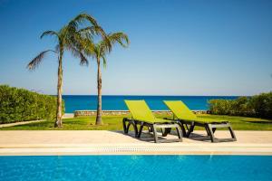 The swimming pool at or near Antonoglou Beach Villas
