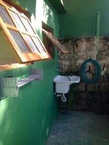 A bathroom at Casa e Suite Pé na Areia Ilhabela