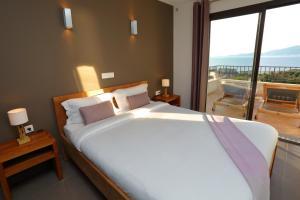Un ou plusieurs lits dans un hébergement de l'établissement Hôtel & Résidence Kallisté Porticcio