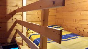 A bunk bed or bunk beds in a room at Mi Cabaña