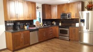 A kitchen or kitchenette at Moss Rose Vacation Home