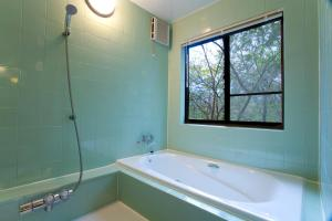 A bathroom at Tabinoteitaku Zao Miyagi HOMANN CONCEPT