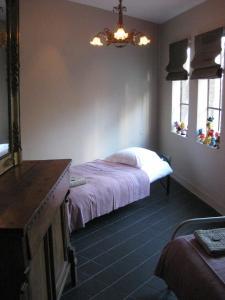 Een bed of bedden in een kamer bij Vakantiehuis Den Bosch