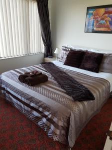 Un ou plusieurs lits dans un hébergement de l'établissement The Chocolate Box