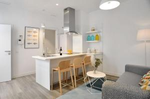 Cuisine ou kitchenette dans l'établissement Aspasios Gran Via Apartments