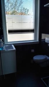 Salle de bains dans l'établissement slijterij-zandvoort