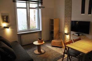 A seating area at Apartament Cracow