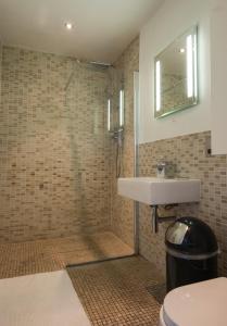 A bathroom at Stylish Central London Apartment