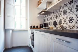 Кухня или мини-кухня в Casa Via Dandolo