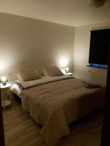 A bed or beds in a room at Fossvegur