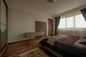 A bed or beds in a room at Samali Residence