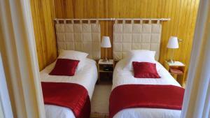 Un ou plusieurs lits dans un hébergement de l'établissement Garden Studio Chantilly