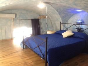 Lova arba lovos apgyvendinimo įstaigoje La casa di Elisa