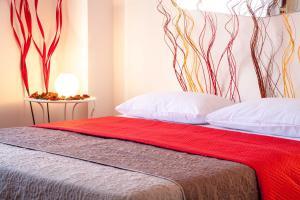 Letto o letti in una camera di Malu Apartments