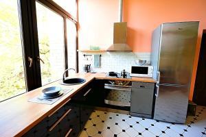 A kitchen or kitchenette at Jurmala Apartments