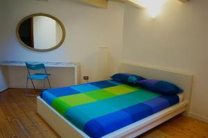 Letto o letti in una camera di Studio Apartment Vicolo Lavandai