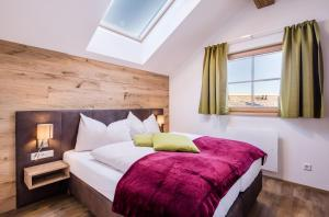 Cama o camas de una habitación en Chaletdorf-Fanningberg