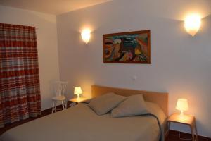 A bed or beds in a room at Casa da Praia | Luz Beach