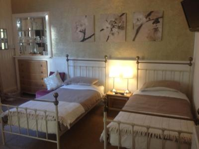 A bed or beds in a room at Cameron Guest House
