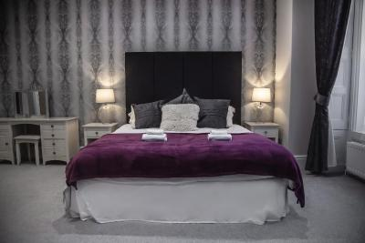 A bed or beds in a room at Kemps Country House