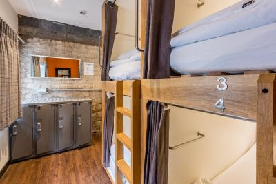 A bunk bed or bunk beds in a room at CoDE Pod Hostels - THE LoFT