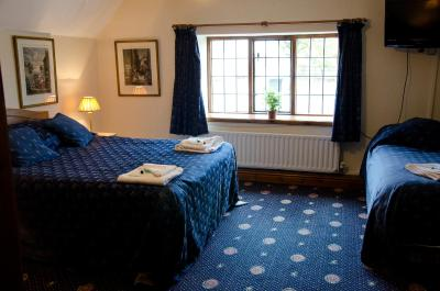 A bed or beds in a room at The Halfway House Inn