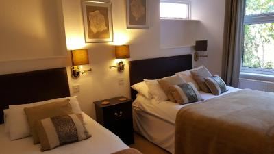A bed or beds in a room at Colebrook Guest House