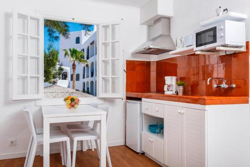 A kitchen or kitchenette at Carema Garden Village