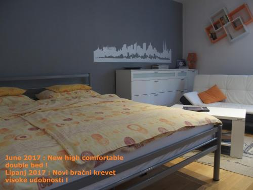 A bed or beds in a room at Apartman Design Maksimir