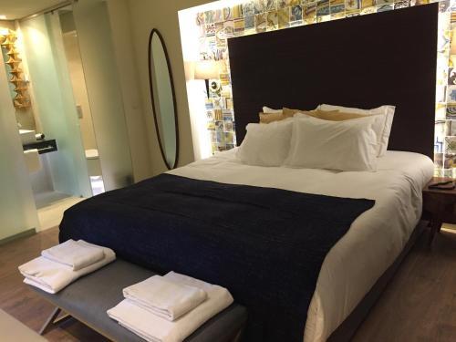 Posteľ alebo postele v izbe v ubytovaní Dalma Old Town Suites