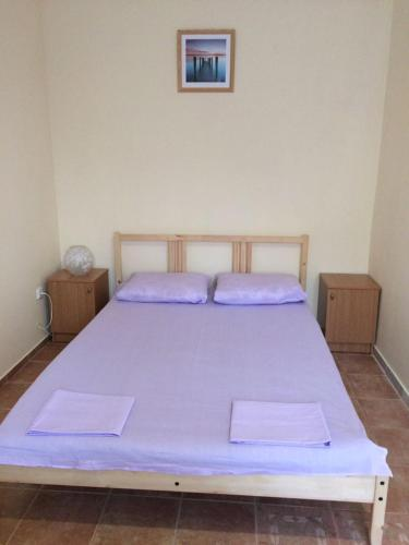 A bed or beds in a room at Guest House Berezhok