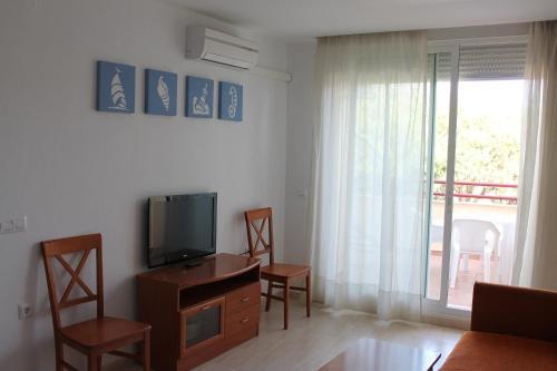 Телевізор і / або розважальний центр в Apartamentos Turisticos Caños de Meca