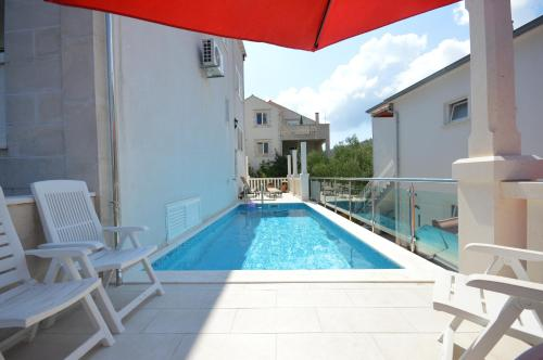The swimming pool at or near Rezidence Castello Apartments