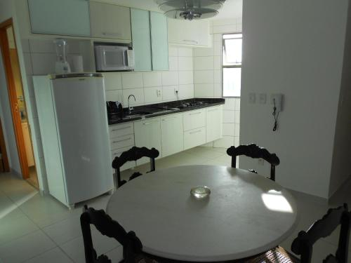 A kitchen or kitchenette at Flat Beira Mar