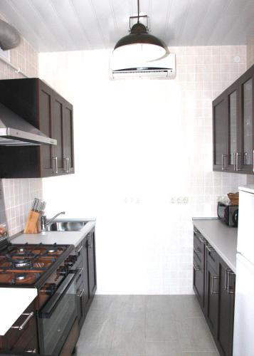 A kitchen or kitchenette at Guest House Azov Inn