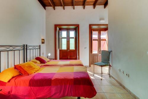Een bed of bedden in een kamer bij Villa Bayón