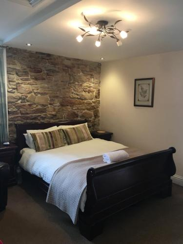 A bed or beds in a room at The Ship Inn