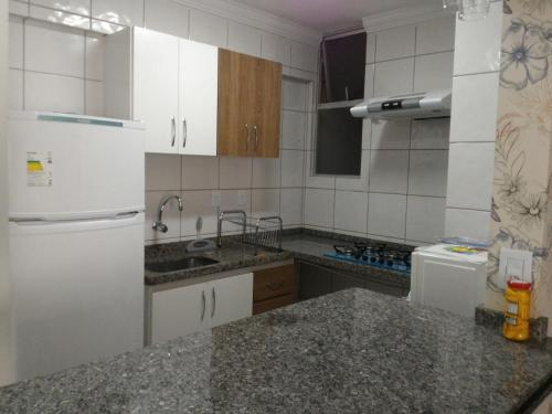 A kitchen or kitchenette at Rio Quente Thermas Paradise