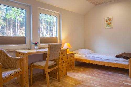 Ein Bett oder Betten in einem Zimmer der Unterkunft Biohotel Spöktal
