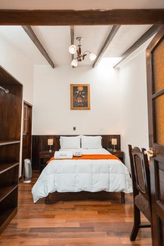 Cama o camas de una habitación en Inka's Stone Boutique