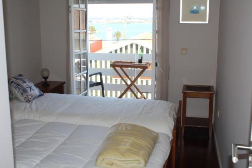 Uma cama ou camas num quarto em Belle View Apartment