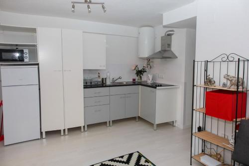 A kitchen or kitchenette at La Cala Finestrat Apartment