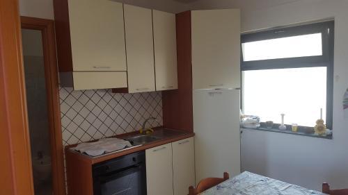 A kitchen or kitchenette at Villaggio del Golfo