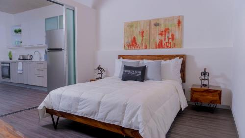 A bed or beds in a room at San Jose Corporate Stays Arborea Flats Suites