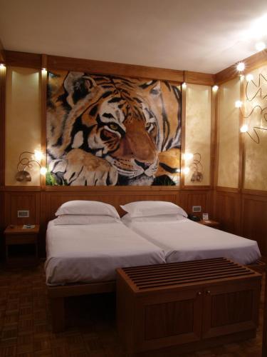 Кровать или кровати в номере Hotel Star