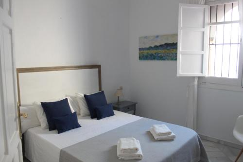 A bed or beds in a room at Life Apartments Catedral