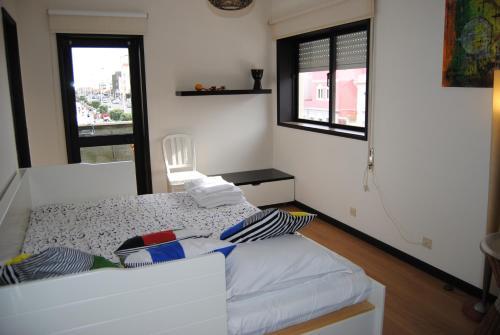 Uma cama ou camas num quarto em Diamante Azul Barra Beach Apartment