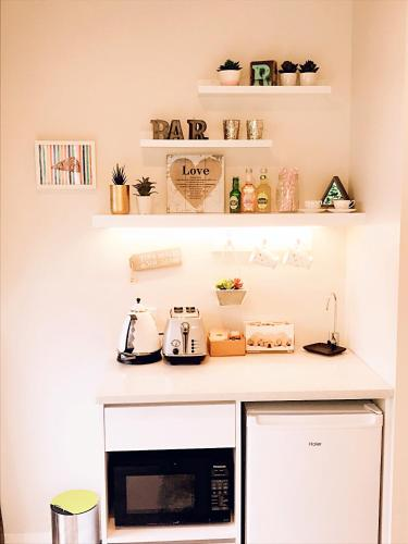 A kitchen or kitchenette at New Market Cozy Room