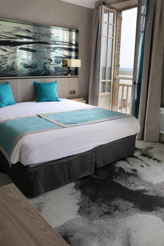 Cama o camas de una habitación en Les Terrasses Poulard