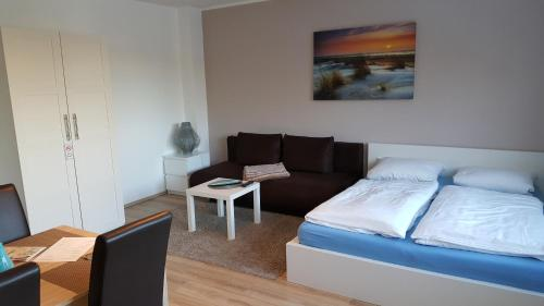 A bed or beds in a room at Ambiente Apartment